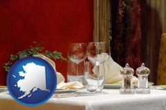 alaska map icon and a French restaurant table setting