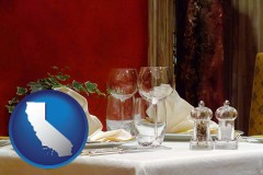 california map icon and a French restaurant table setting