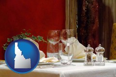 idaho map icon and a French restaurant table setting