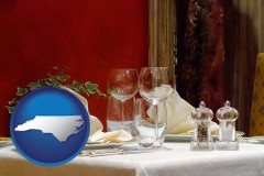 north-carolina map icon and a French restaurant table setting