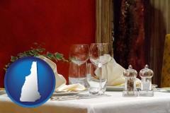 new-hampshire map icon and a French restaurant table setting