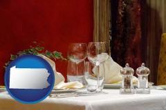 pennsylvania map icon and a French restaurant table setting