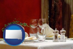 south-dakota map icon and a French restaurant table setting