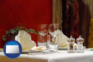 a French restaurant table setting - with North Dakota icon